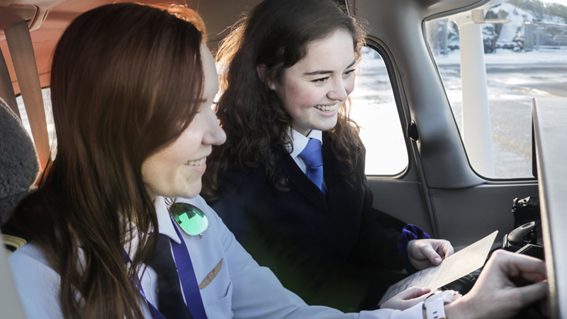 female-flight-instructor-and-student-pilot-during-flight-lesson-website-image