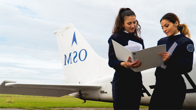 female-student-pilots-standing-next-to-osm-aircraft-website-image